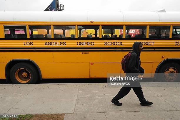 Student on his way to school walks past a Los Angeles Unified School District school, in Los Angeles, California on February 13, 2009. California...