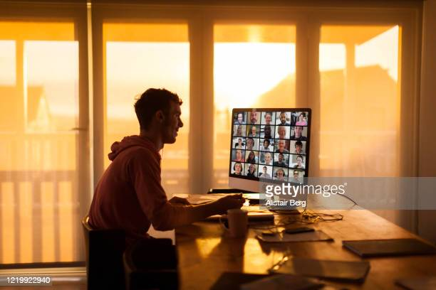 student on video call from his home during lockdown - working from home stock pictures, royalty-free photos & images