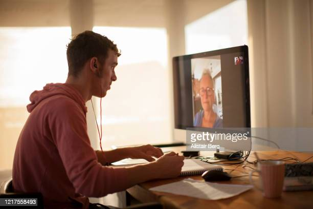 student on videocall on computer during lockdown - conference call stock pictures, royalty-free photos & images