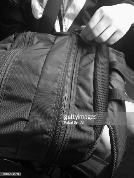 student opens a school bag - rafael ben ari foto e immagini stock
