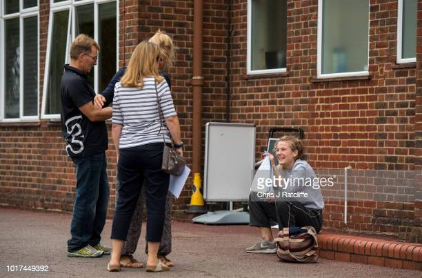 A student opens her A Level exam results amongst parents at Lady Eleanor Holles school on August 16 2018 in Hampton United Kingdom A level...