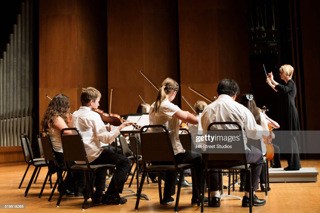 Student orchestra playing on stage : Stock Photo