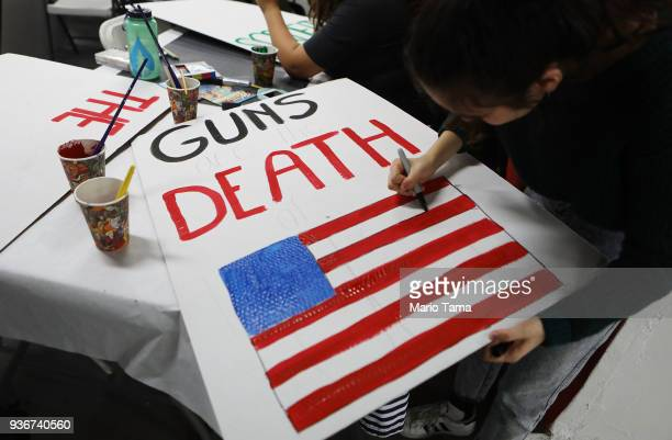 A student paints a sign to be carried at the upcoming March for Our Lives Los Angeles on March 22 2018 in Los Angeles California More than 500000 are...