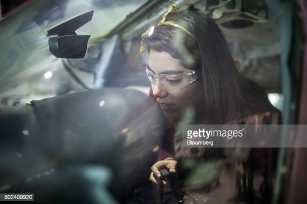 Student Paola Giselle Velazco works inside the cockpit of a plane at the National Aeronautics University of Queretaro in Queretaro Mexico on Thursday...