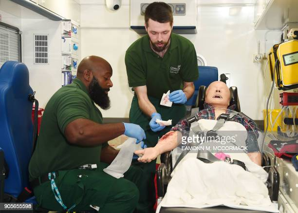 Student paramedics practice caring for a patient at Coventry University Science and Health Building in Coventry central England on January 16 2018...