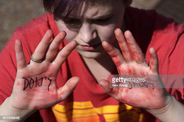 A student participates in a protest against gun violence February 21 2018 outside the White House in Washington DC Hundreds of students from a number...
