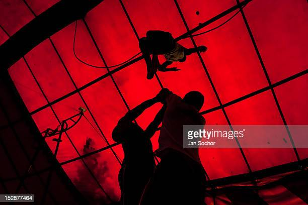 A student performs an acrobatic jump during the lessons in the circus school Circo para Todos on 2 June 2012 in Cali Colombia Circo Para Todos...