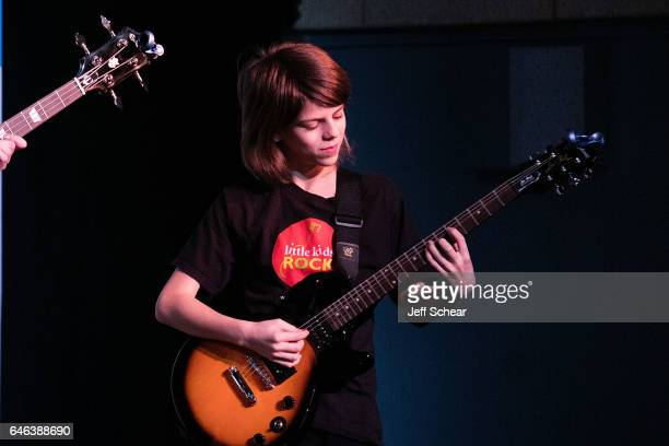 A student performs at Chicago Public School Announces Music Program Expansion With Little Kids Rock at Franklin Fine Arts Center Auditorium on...