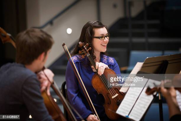 student playing in college string quartet - musical quartet stock photos and pictures