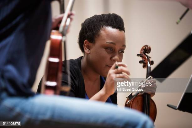 Student playing violin in string quartet