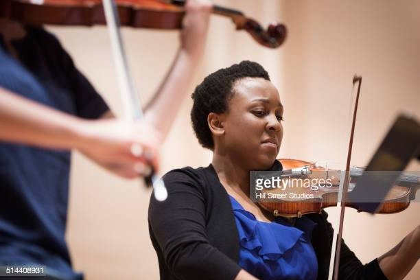 student playing violin in string quartet - string quartet stock photos and pictures