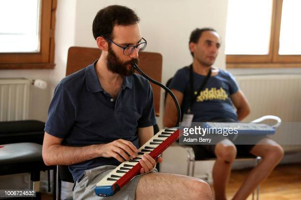 Student plays a melodica during a lesson at Yiddish Summer Weimar on July 27, 2018 in Weimar, Germany. The annual five-week summer institute and...