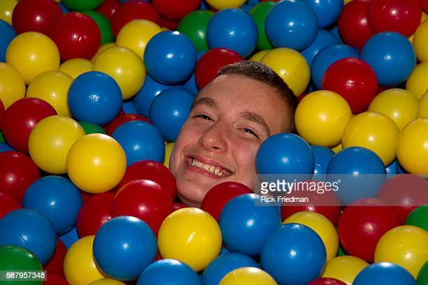 Student plays in a large container of balls in the Game Room as a reward for behaving, at the Judge Rotenberg Center in Canton, MA on September 24,...