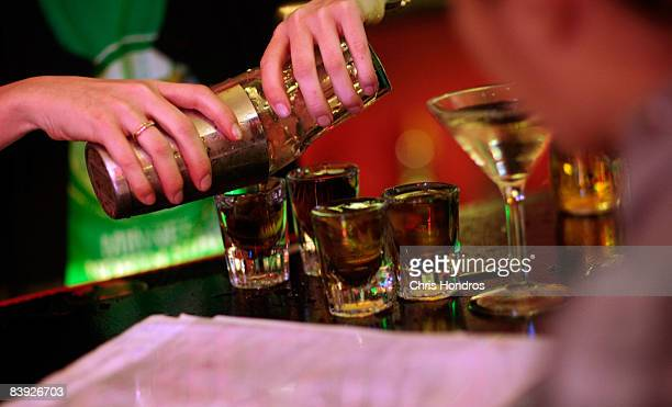 A student pours out drinks at the New York Bartending School December 5 2008 in New York City Enrollment is up at the bartending school especially in...