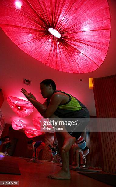 A student practice Bikram Yoga at a fitness center on September 28 2006 in Chongqing Municipality China Bikram Yoga is a style of yoga developed by...