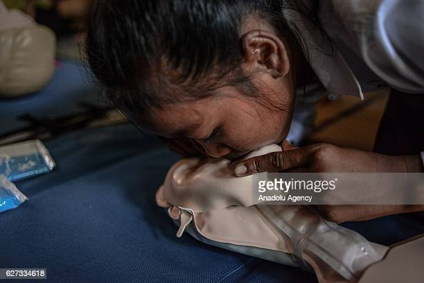A student practices CPR on a mannequin during a water safety and drowning prevention class on Monday November 28 2016 in Prey Veng province