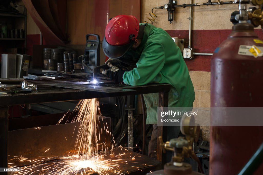 A student practices plasma cutting during a class at the Penn Commercial Business/Technical School in Washington, Pennsylvania, U.S., on Tuesday, Aug. 15, 2017. While fracking has created a bonanza of jobs, displaced coal miners and their communities are sometimes left out of the boom. Thats because many of the jobs require highly technical skills and are often going to experienced workers brought in from out of state who then move on to the next job without sinking roots. Photographer: Stephanie Strasburg/Bloomberg via Getty Images