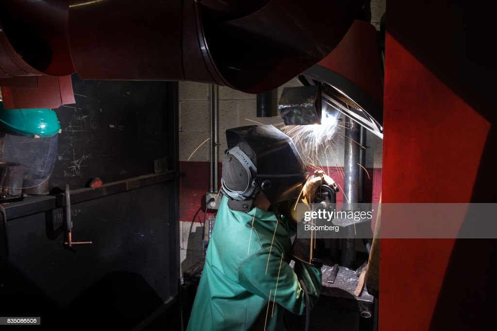 A student practices welding techniques during a class at the Penn Commercial Business/Technical School in Washington, Pennsylvania, U.S., on Tuesday, Aug. 15, 2017. While fracking has created a bonanza of jobs, displaced coal miners and their communities are sometimes left out of the boom. Thats because many of the jobs require highly technical skills and are often going to experienced workers brought in from out of state who then move on to the next job without sinking roots. Photographer: Stephanie Strasburg/Bloomberg via Getty Images