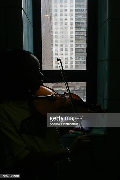 A student practices with his violin at KIPP Academy in the South Bronx part of a network of public middle schools that is becoming a model for...