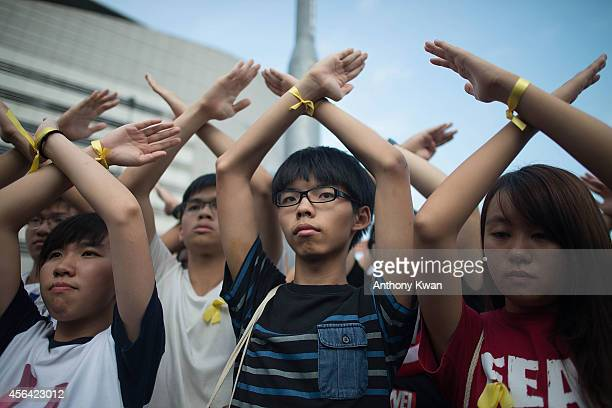 Student prodemocracy group Scholarism convenor Joshua Wong makes a gesture at the Flag Raising Ceremony at Golden Bauhinia Square on October 1 2014...