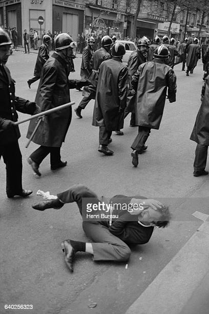 A student protester falls to the floor after being bludgeoned by the police in the Latin Quarter of Paris For two months Paris saw many violent...
