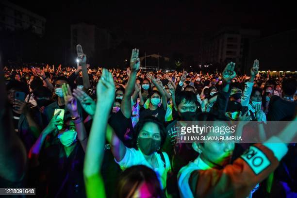 Student protesters flash the threefingered Hunger Games salute during an antigovernment rally at Mahidol University in Nakhon Pathom on August 18...
