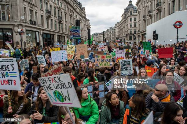 Student protesters hold a sit down demonstration at the YouthStrike4Climate student march at Oxford Circus on April 12 2019 in London United Kingdom...