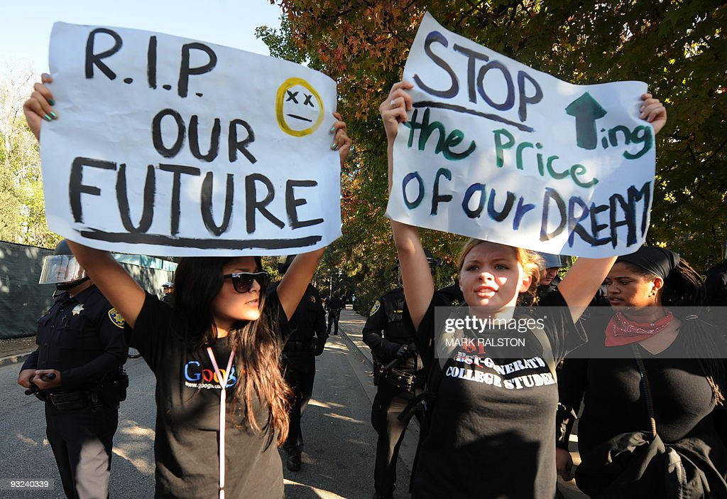 Student protesters hold banners outside a police line during a protest against an increase in student fees at the UCLA campus in Los Angeles on November 19, 2009. The University of California Board of Regents approved a 32 percent tuition increase. AFP PHOTO/Mark RALSTON