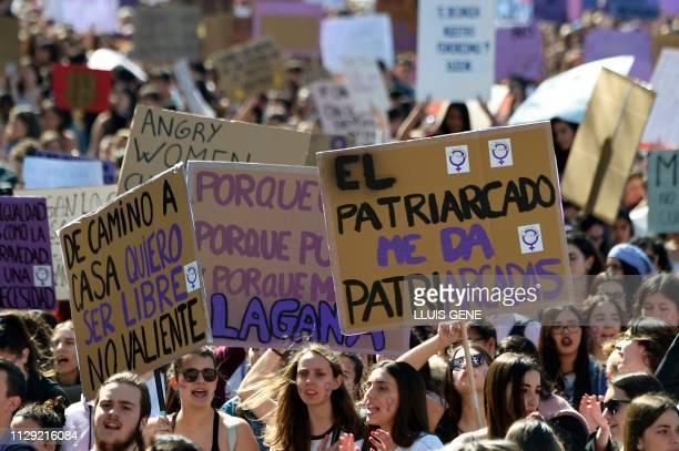 Student protesters hold signs including 'On my way back home I want to be free not brave' during a demonstration marking International Women's Day in...