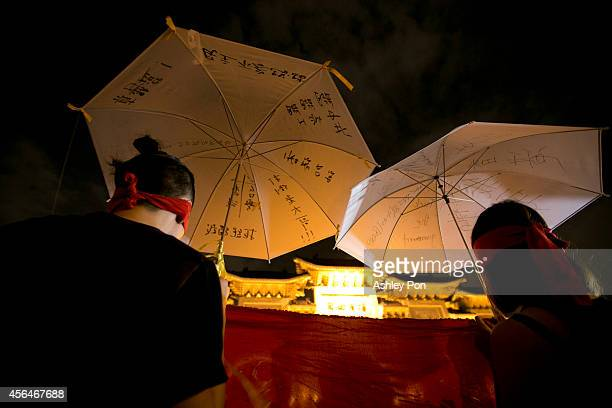 Student protesters hold umbrellas with messages written on the fabric in front of Liberty Square to show support for Hong Kong pro democracy rallies...
