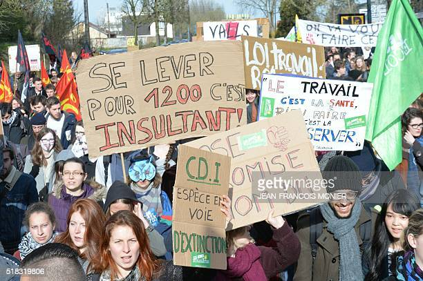 Student protesters holdup placards that read 'getting out of bed for 1200 is an insult' 'CDI employment contract duration Undetermined Endangered...