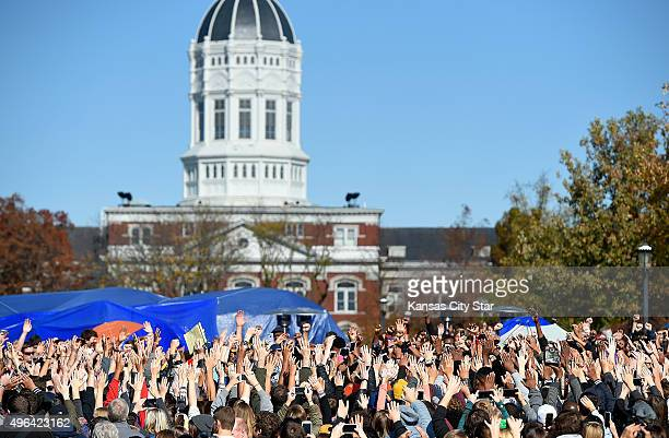 Student protesters on the campus of the University of Missouri in Columbia react to news of the resignation of University of Missouri system...