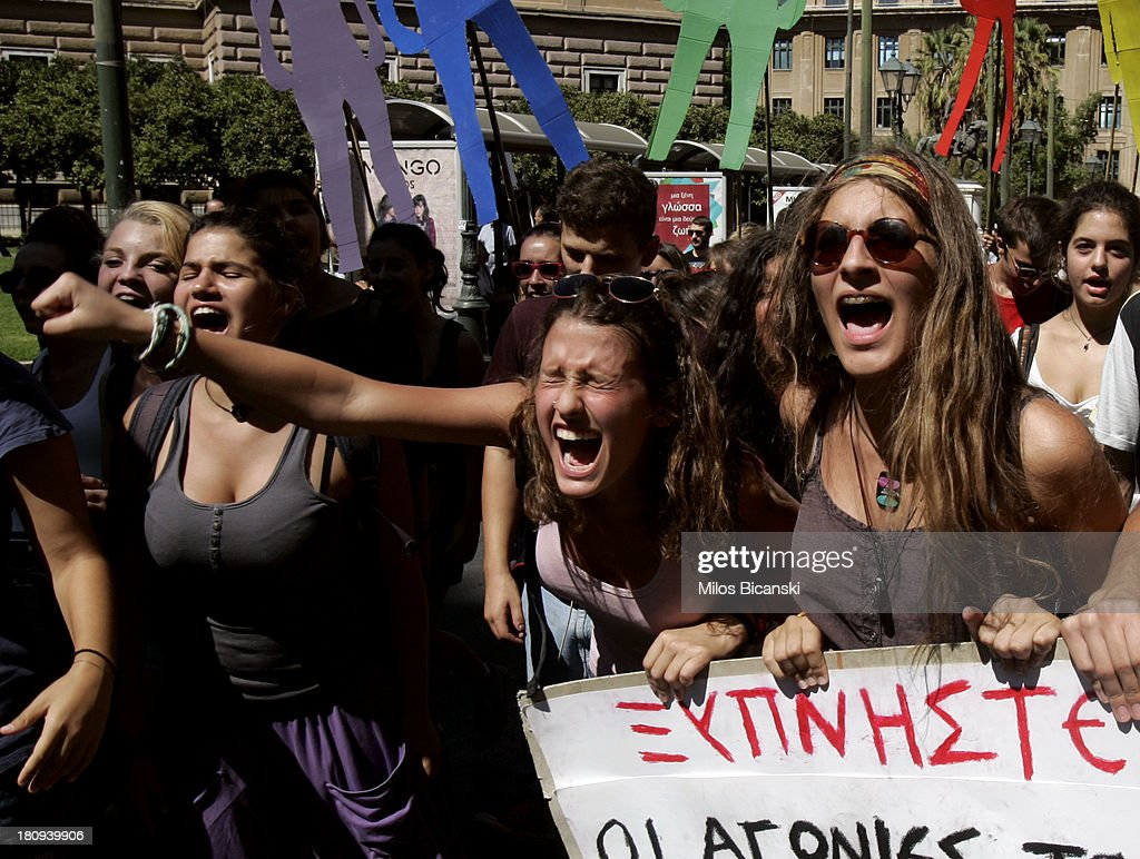 Student protestors hold banners and shout during a demonstration against austerity and job cuts on September 18, 2013 in Athens, Greece. As part of the redeployment plan in the country reeling from six years of recession, civil servants have to accept new posts or spend eight months on reduced salaries as alternative posts are found, with the risk of losing their jobs altogether.