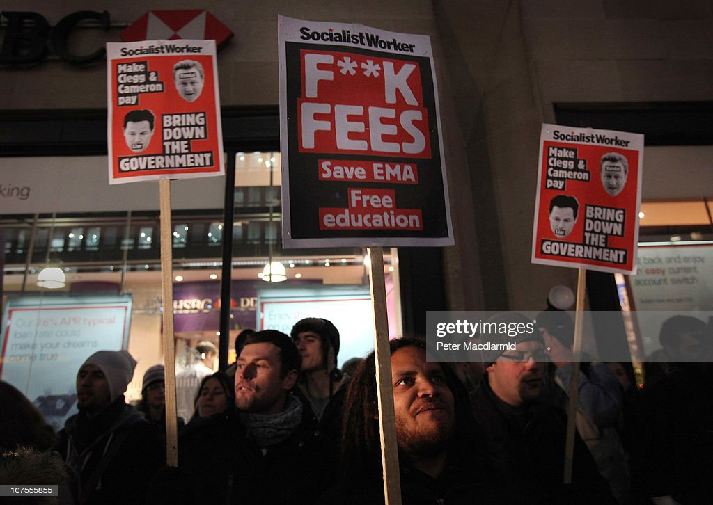 Student protestors hold up placards opposite the Department for Business on December 13, 2010 in London, England. Students are calling on the government not to scrap the Education Maintenance Allowance (EMA). The EMA was designed to help poorer pupils to stay in education.