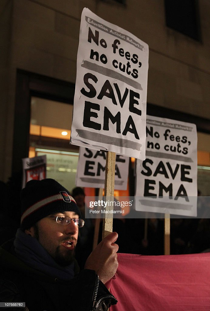 Student protestors hold up placards outside the Department For Business on December 13, 2010 in London, England. Students are calling on the government not to scrap the Education Maintenance Allowance (EMA). The EMA was designed to help poorer pupils to stay in education.