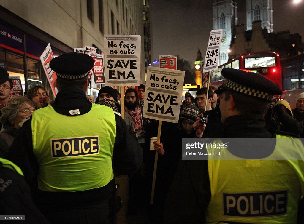 Student protestors stand with placards opposite the Department for Business on December 13, 2010 in London, England. Students are calling on the government not to scrap the Education Maintenance Allowance (EMA). The EMA was designed to help poorer pupils to stay in education.