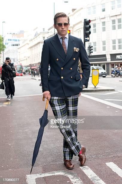 Student Ranec Hughes wears Hackett Trousers Blue Tiger Jacket Gieves Hawkes shirt Ralph Lauren Tie Churches Shoes on day 2 of London Collections Men...