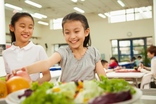 Student reaching for healthy food in school cafeteria 460901359