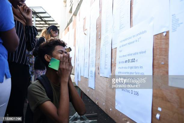 Student reacts after receiving his baccalaureat examination results at a high school in Saint-Denis de la Reunion, on July 5, 2019. - French...