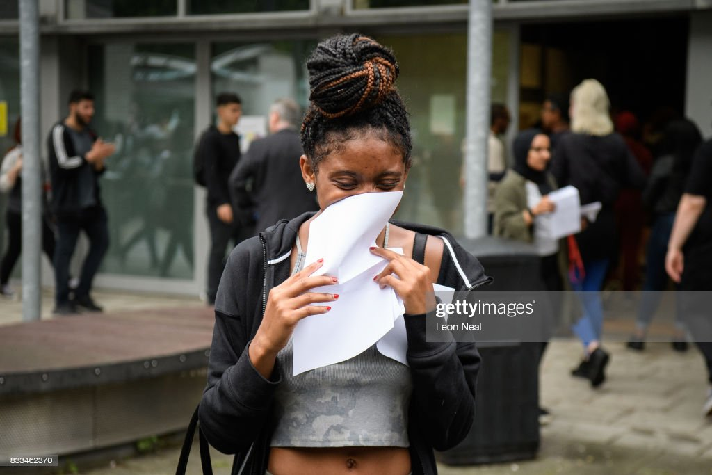 A student reacts as she receives her positive A level results at City and Islington College on August 17, 2017 in London, England. The number of students receiving the highest grades of A and A* grades has increased for the first time in six years.