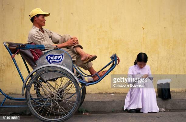 Student Reading by Rickshaw Driver