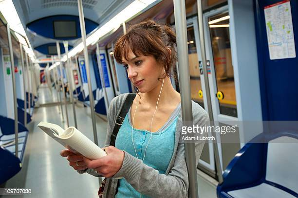 Student reading in subway
