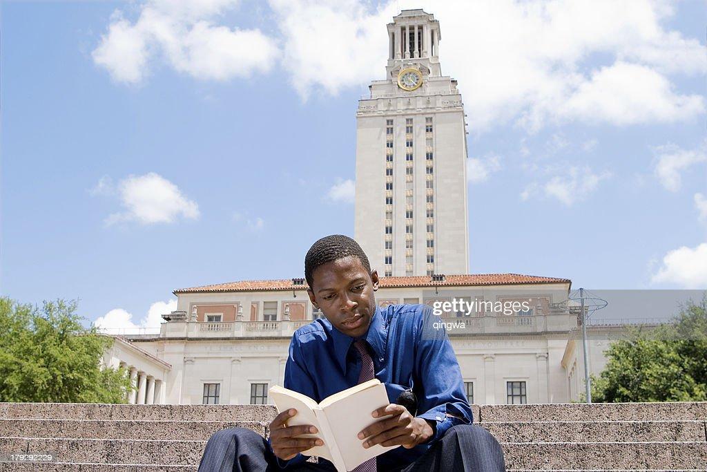 Student Reading on Steps, Main Building, University of Texas, Austin : Stock Photo