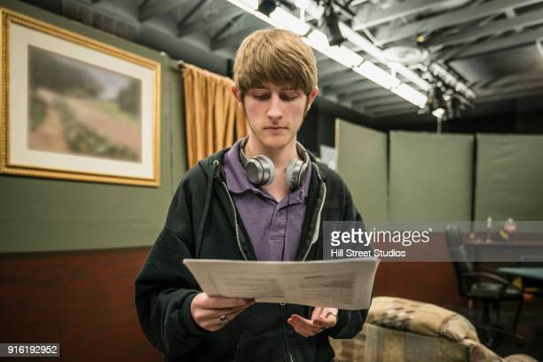 Student reading script in theater class