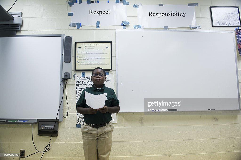 A student reads a homework assignment in the sixth grade social studies class of John Scheibel, a teacher for the Washington Jesuit Academy in Northeast. Scheibel is a former Hill staffer and lobbyist.