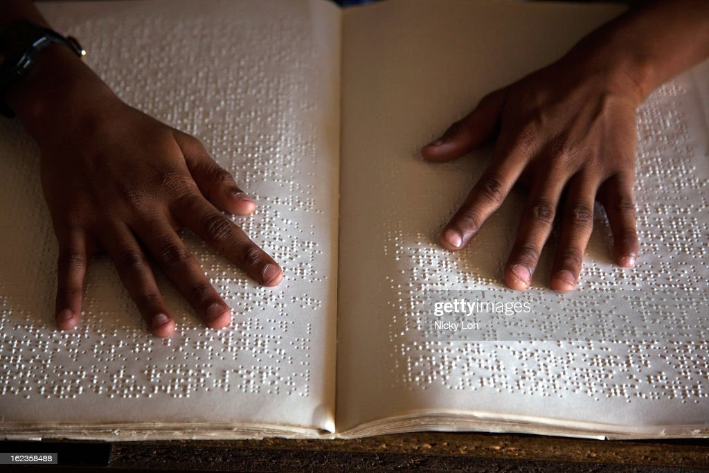 A student reads Braille with her hands at the Government High School for The Blind on February 22, 2013 in Kadapa, India. The school which is funded by the government looks after 50 visually impaired or blind students. India has the largest number of people with visual impairment globally. According to the World Health Organization (WHO), an estimated 63 million people in India are visually impaired, and of these approximately 8 million people are blind.