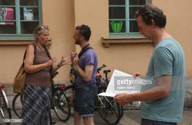 A student reads sheet music for a Yiddishlanguage song during Yiddish Summer Weimar on July 27 2018 in Weimar Germany The annual fiveweek summer...