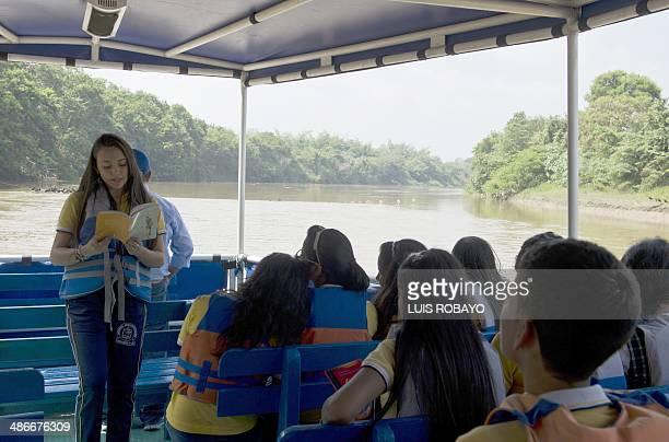 A student reads to her classmates the novel Memoria de mis putas tristes by late Nobel Prize laureate in Literature Gabriel Garcia Marquez in Cali...