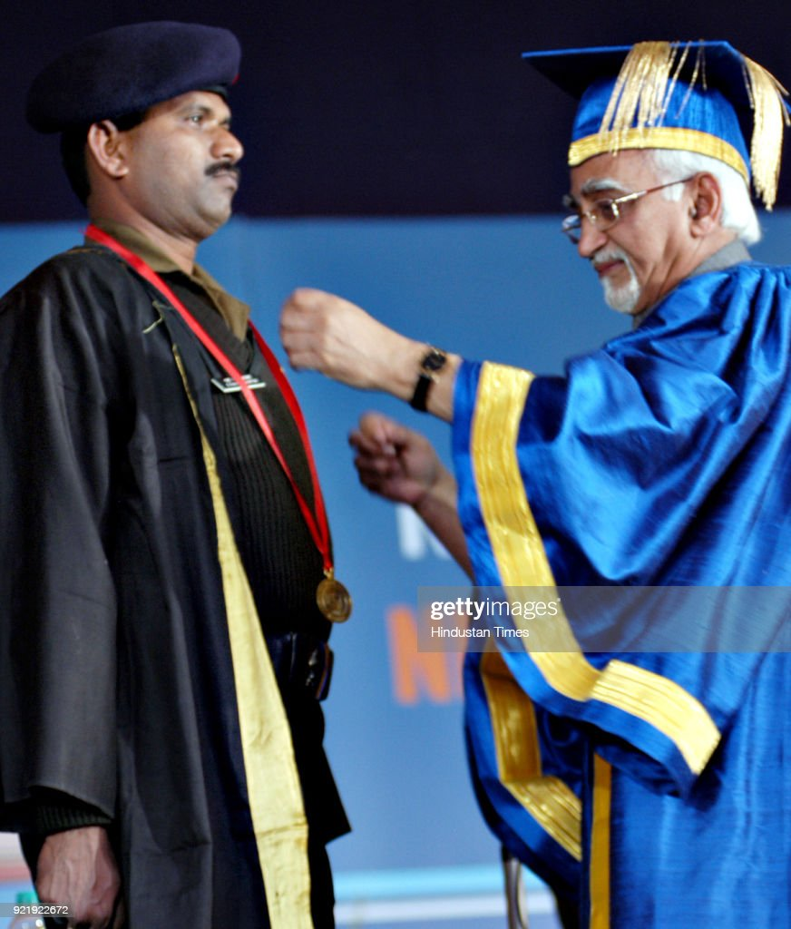 A Student receiving the honour from Vice president Hon'ble Md. Hamid Ansari at the 19th Convocation of Indira Gandhi Open University (IGNOU) at IGNOU Campus in New Delhi.