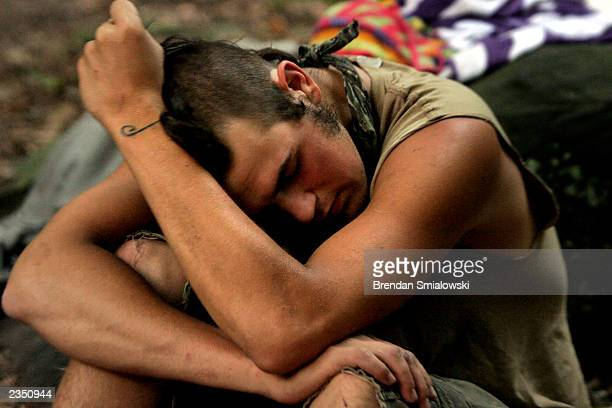 A student rests while camping out at the Center for Attention and Related Disorders camp at the Great Hollow Wilderness School July 30 2003 in New...